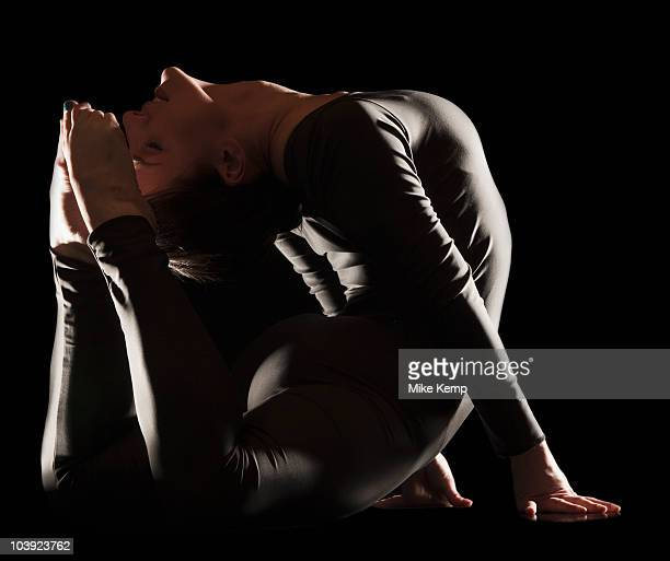 Contortionist bending over backwards