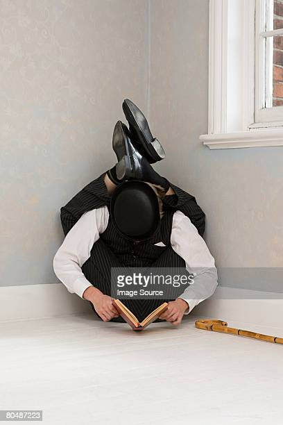 contortionist reading a book - contortionist stock photos and pictures