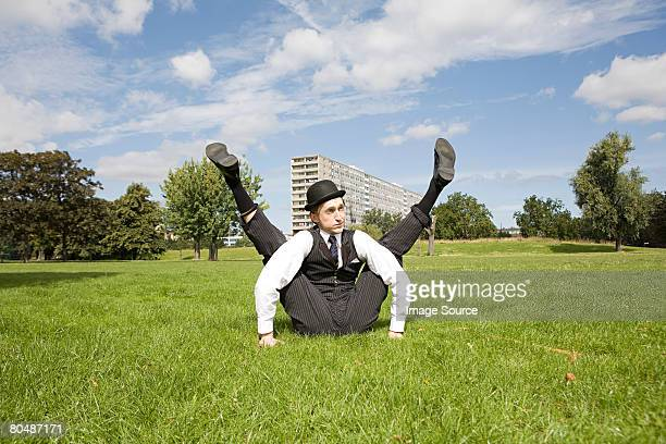 Contortionist sitting in a field