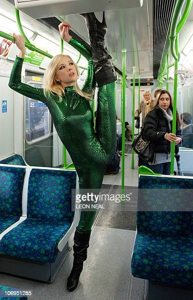 Contortionist 'Zlata' from Kazakhstan poses on a London underground train during a photocall to promote the Erotica 2010 show in west London on...