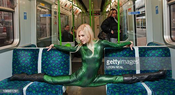 Contortionist Zlata From Kazakhstan Poses On A London Underground Train During A Photocall To