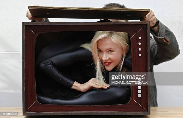 Contortionist Zlata Poses Into A Fake Body Of A Television As She Promotes The Initiative