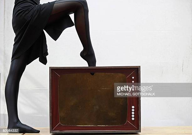 Contortionist Zlata Steps Into A Fake Body Of A Television As She Promotes The Initiative