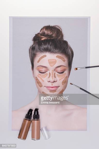 Contouring make up on young woman