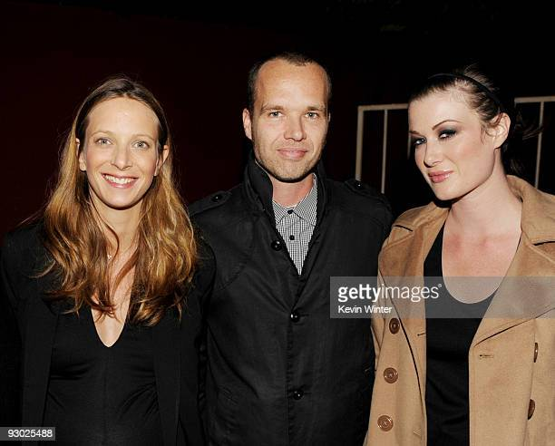 Contour's Director of Photography Elodie Mailliet, former iStockphoto founder and CEO Bruce Livingstone and his wife Brianna pose at a party for...