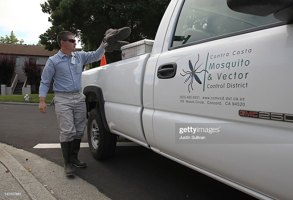 Contra Costa County Mosquito and Vector Control District technician David Wexler puts his boots in his truck before inspecting a creek on June 29, 2012 in Pleasant Hill, California. As reports of mosquitoes with West Nile virus are increasing across the country and several people have been confirmed to be infected by the potentially dangerous disease, the Contra Costa County Mosquito and Vector Control District is testing mosquito larvae found in standing water throughout the county and is using mosquito fish and BVA Larvacide oils to eradicate the pest.