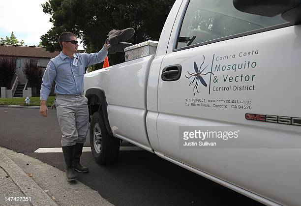 Contra Costa County Mosquito and Vector Control District technician David Wexler puts his boots in his truck before inspecting a creek on June 29...
