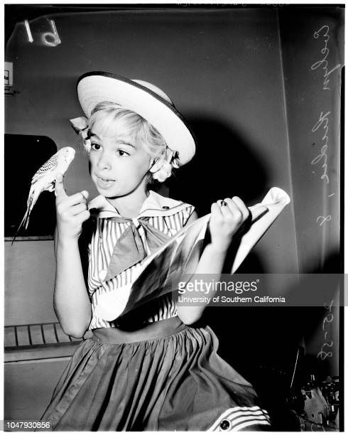 Contract approval, 25 July 1958. Evelyn Rudie -- 8 years;Parakeet 'Pootsy'.;Caption slip reads: 'Photographer: Jim Brezina. Date: . Assignment:...