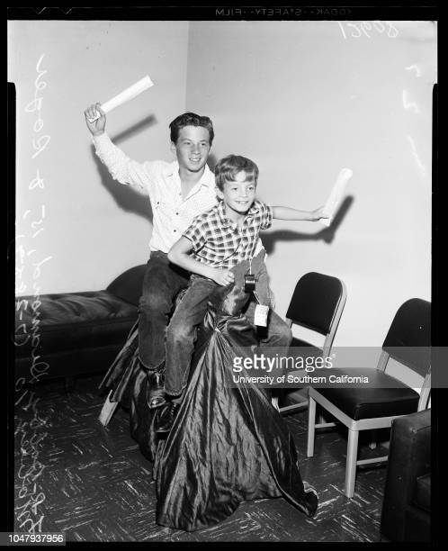 Contract approval 28 July 1959 Bobby Diamond 15 yearsRoger Mobley 10 yearsCaption slip reads 'Photographer Mitchell Date Reporter Pony Garner...