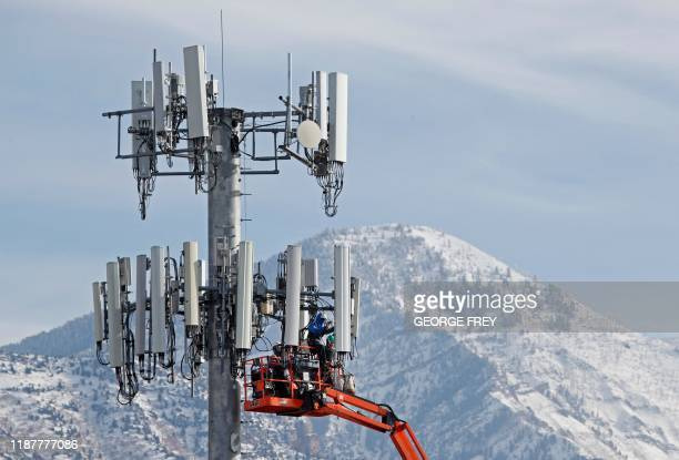 TOPSHOT A contract crew for Verizon works on a cell tower to update it to handle the new 5G network in Orem Utah on December 10 2019 The new 5G...
