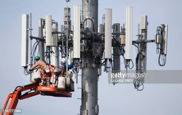 A contract crew for Verizon works on a cell tower to update it to handle the new 5G network in Orem Utah on December 10 2019 The new 5G cellular...