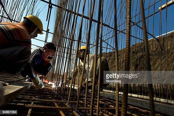 Contract laborers work in the Brandix India Apparel City Special Economic Zone in Vishakapatnam Andhra Pradesh India on Wednesday April 2 2008 As...