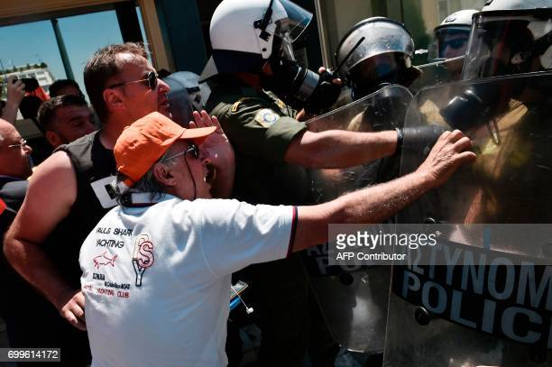 TOPSHOT Contract municipal workers scuffle with police as they attempted to enter the greek parliament during a protest against layoffs in Athens on...