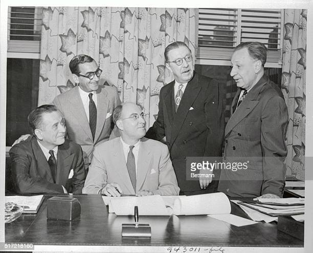 A contract was signed in the office of Joseph H McConnell NBC President in the RCA Building Left to right are Leland Hayward Irving Berlin Joseph H...