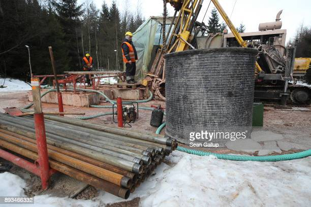 Contract workers for Deutsche Lithium GmbH operate a machine taking mineral samples from 300 meters below the surface at a site on December 13 2017...