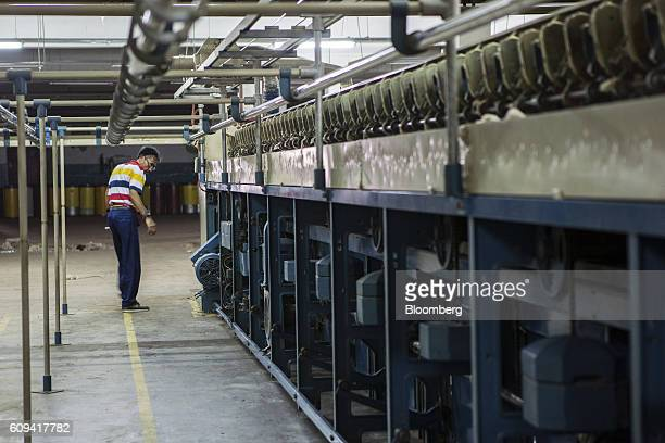 A contractor disassembles a spinning machine which has been sold in an abandoned textile mill in Karachi Pakistan on Monday Sept 10 2016 Exporters...