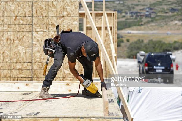 A contractor drills a wood stud while framing a home under construction Park City Utah US on Friday Aug 14 2020 US home construction starts rose 17%...