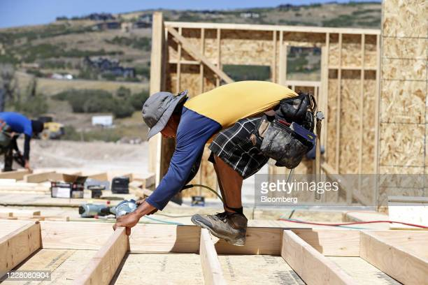 A contractor frames a home under construction in Park City Utah US on Friday Aug 14 2020 US home construction starts rose 17% in June with builders...