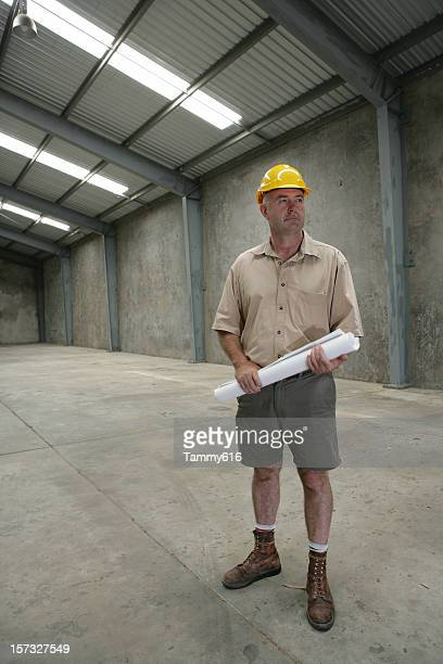 Contractor Inspecting Building Site