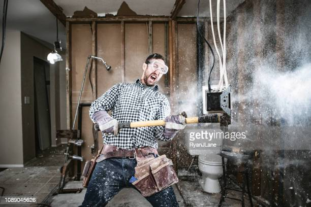 contractor man doing home improvement and demolition - demolishing stock pictures, royalty-free photos & images