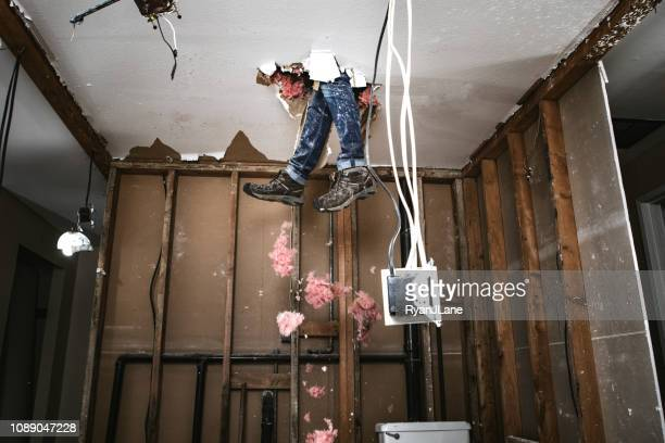 contractor man doing home improvement and demolition - negative emotion stock pictures, royalty-free photos & images