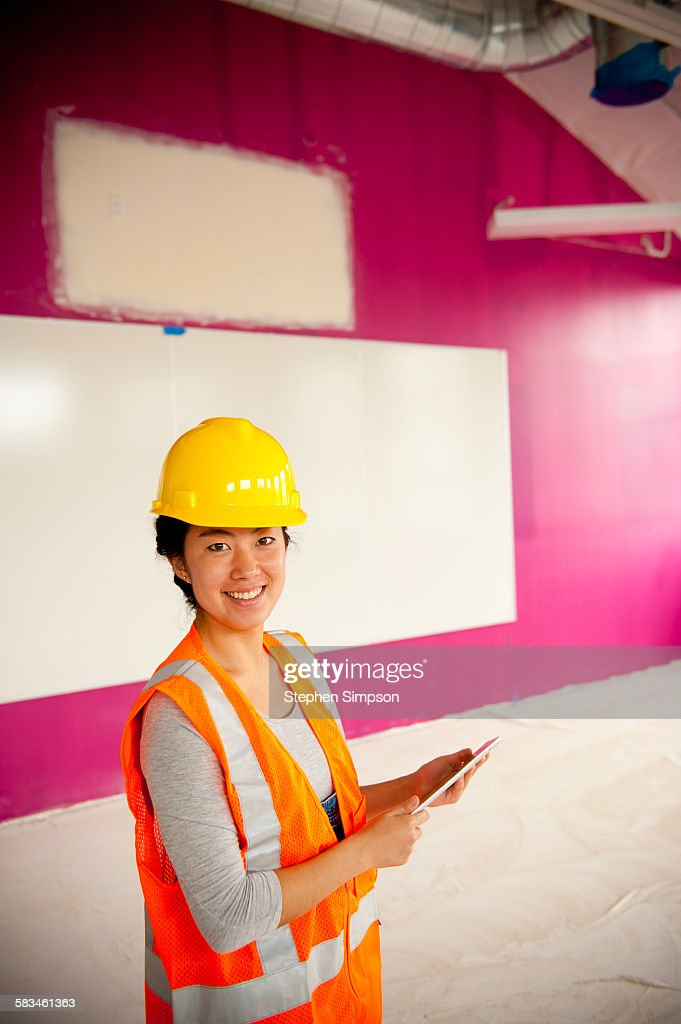 contractor on school construction site : Stock Photo