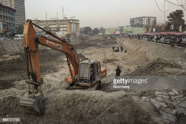 Contractor operates a Hitachi Ltd. Excavator in the polluted Kabul River in Kabul, Afghanistan, on Sunday, Nov. 5, 2017. The Afghan economy is said...