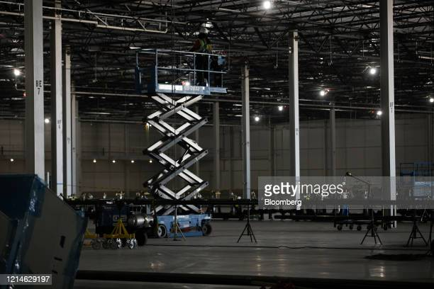 Contractor operates a lift to install piping in the body shop area of the Lucid Motors Inc. Manufacturing facility while under construction in Casa...