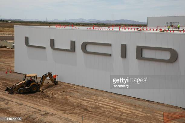 Contractor operates an excavator outside the Lucid Motors Inc. Manufacturing facility while under construction in Casa Grande, Arizona, U.S., on...