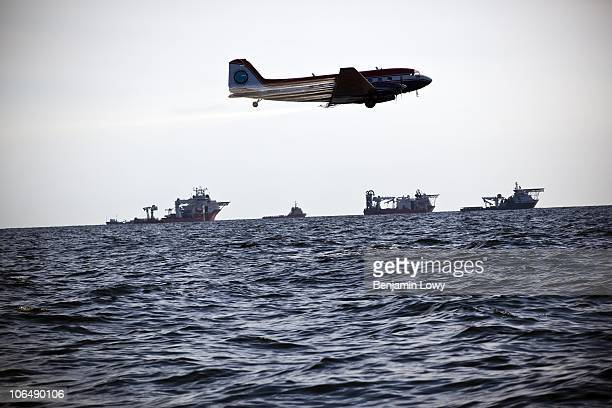 Contractor planes spray chemical dispersant over oil coated Gulf of Mexico waters at the site of a massive oil spill following the sinking of the BP...