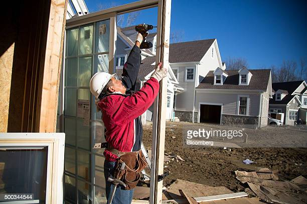 A contractor prepares a sliding door for a home under construction at the Toll Brothers Inc Enclave at Rye Brook housing development in Rye Brook New...