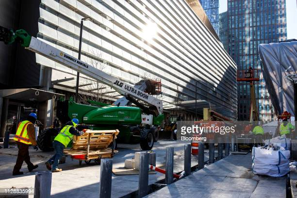 A contractor pushes material at the Hudson Yards development under construction in New York US on Tuesday March 5 2019 Driving the $25 billion...
