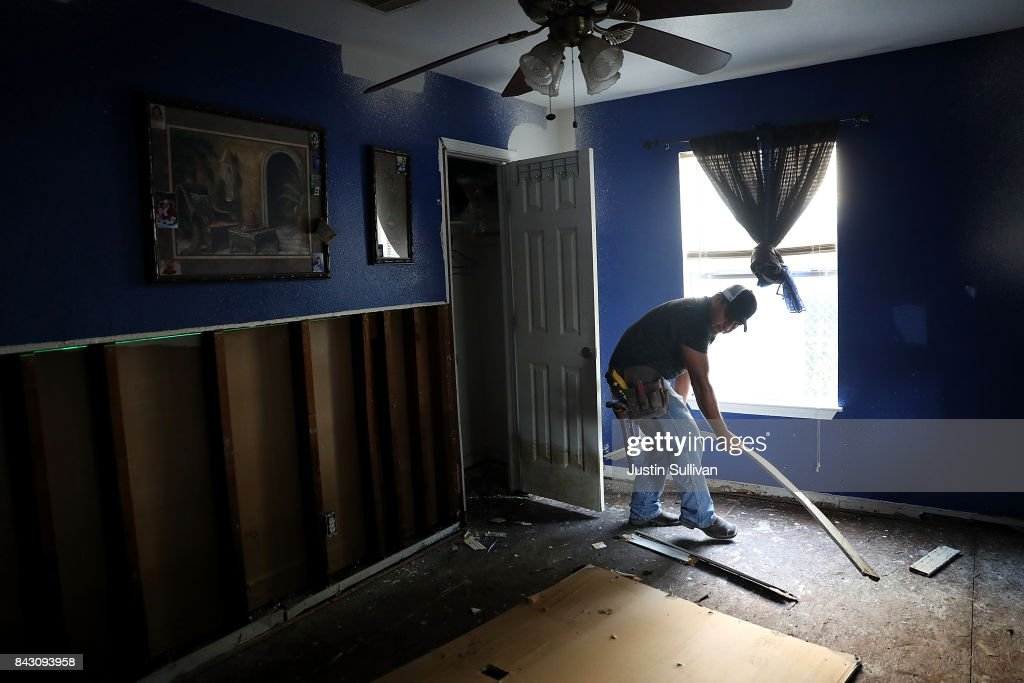 A contractor removes moldy materials from a flood damaged home on September 5, 2017 in Houston, Texas. Over a week after Hurricane Harvey hit Southern Texas, residents are beginning the long process of recovering from the storm.