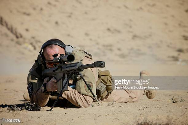 A U.S. Contractor sights in a Barrett M82A1 rifle on a range in Kunduz, Afghanistan.