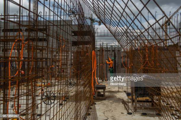 Contractor stands between mesh reinforcement panels during construction at the Reserva Paulista residential complex in Sao Paulo, Brazil, on...