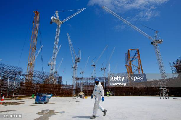 Contractor walks across the Reactor Unit Two on the construction project for Hinkley Point C nuclear power station, operated by Electricite de France...