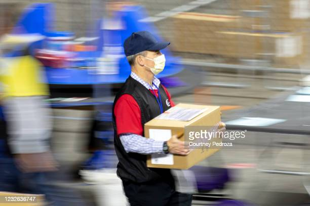 Contractor working for Cyber Ninjas, who was hired by the Arizona State Senate transports ballots from the 2020 general election at Veterans Memorial...