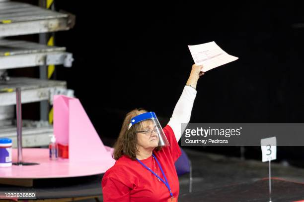Contractor working for Cyber Ninjas, who was hired by the Arizona State Senate, works to recount ballots from the 2020 general election at Veterans...