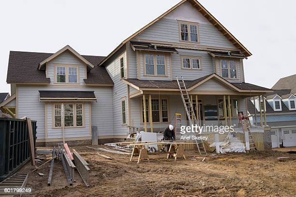 Contractor working on house at construction site