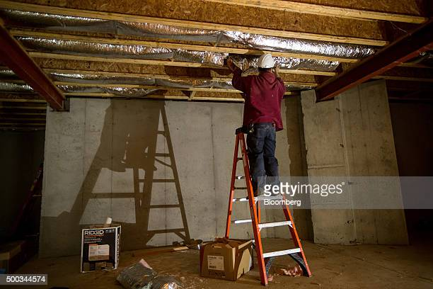 A contractor works in the basement of a home under construction at the Toll Brothers Inc Enclave at Rye Brook housing development in Rye Brook New...
