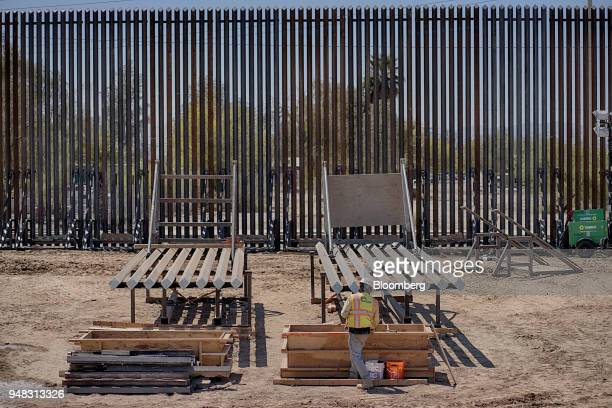 A contractor works on the border wall in Calexico California on Wednesday April 18 2018 Secretary of Homeland Security Kirstjen Nielsen toured new...