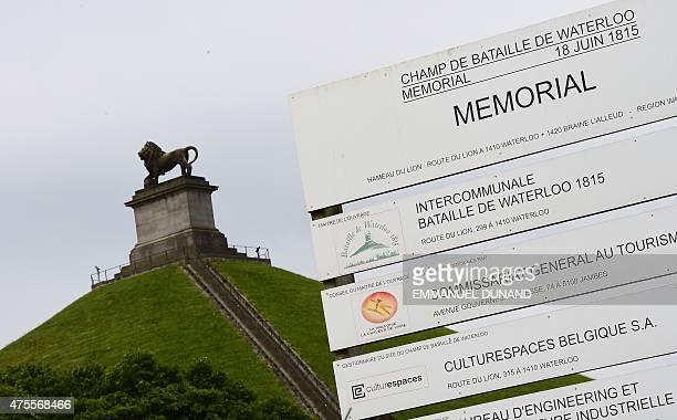 Contractor's board is seen in front of La Butte du Lion , the main memorial monument of the Battle of Waterloo, in front on a field where the 1815...