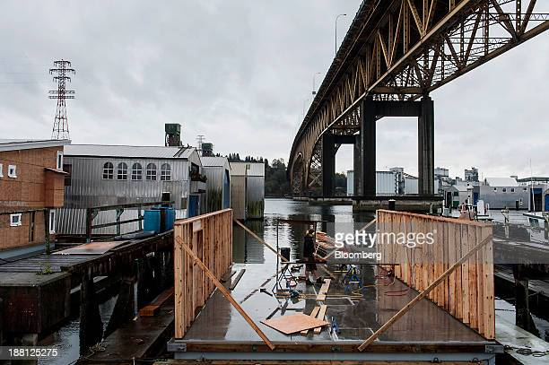 Contractors build the outside walls of a Squamish Nation Marina Group float home during construction in North Vancouver British Columbia Canada on...