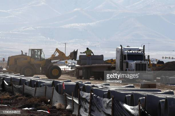 Contractors operate heavy machinery to build roads for a housing development under construction in Lehi, Utah, U.S., on Wednesday, Dec. 16, 2020....