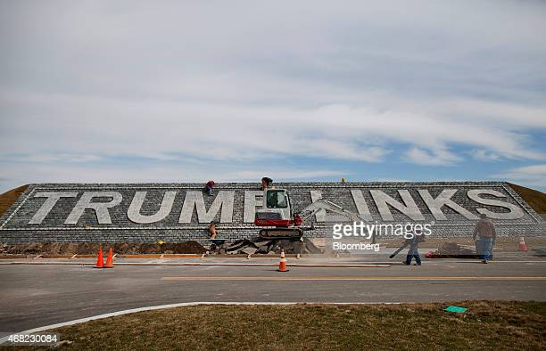 Contractors put the finishing touches on signage at the Trump Links golf course in the Bronx borough of New York YUS on Tuesday March 31 2015 The...