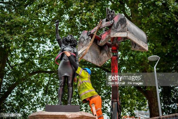 Contractors use ropes to secure A Surge of Power 2020 by prominent British sculptor Marc Quinn which has been installed in Bristol on the site of the...