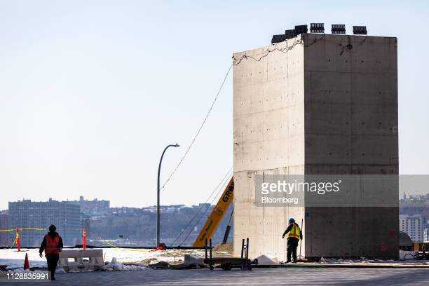 Contractors work at the Hudson Yards development in New York US on Tuesday March 5 2019 Driving the $25 billion development of Hudson Yards is...