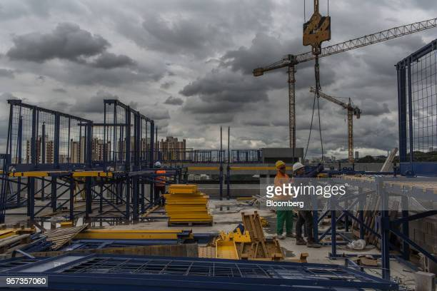 Contractors work during construction at the Reserva Paulista residential complex in Sao Paulo, Brazil, on Wednesday, March 21, 2018. The world's...