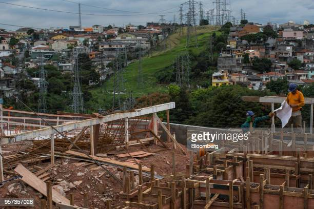 Contractors work during construction of the Reserva Paulista residential complex in Sao Paulo, Brazil, on Wednesday, March 21, 2018. The world's...
