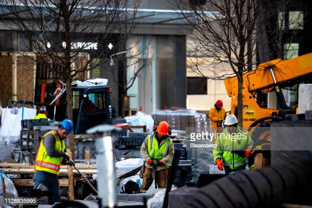Contractors work in front of the retail entrance at the Hudson Yards development in New York US on Tuesday March 5 2019 Driving the $25 billion...